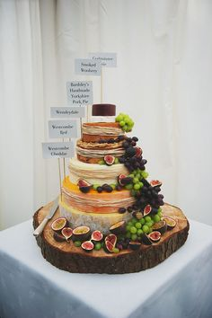 """If you love the look of a traditional wedding cake, but really prefer the sophisticated and healthier savory option of a fruit and cheese plate dessert, you can have your """"cake"""" and eat it too by buying (or creating) a cake made out of cheese wheels. Keep it diverse and balanced by incorporating different types of cheese with figs or fruits - work with an artisan cheese vendor to make sure your """"cake"""" comes out truly delicious and beautiful."""