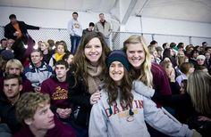 Fans cheer the maroon and gold at the Calvin-Hope hockey matchup.
