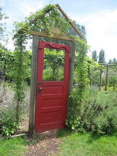 lovely red door entrance to garden