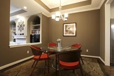 Small Decor Ideas For Dining Room Ceiling Light Above Glass Round Table With Extra Large Rugs Under Modern Chairs And Brown Wall Paint Color Also Using Wood Flooring