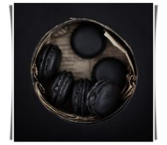 Halloween macaroons- would look great surrounding a skull