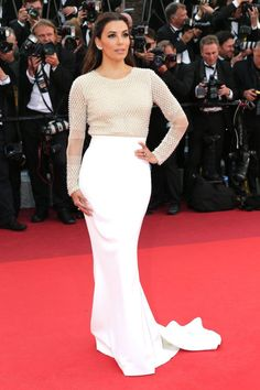 11 May Eva Longoria looked chic in a white and cream gown by Pamella Roland.