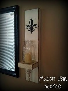 This is my mason jar sconce I made inspired by the one I saw on Shanty-2-Chic.com