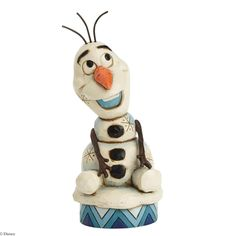 Making his debut to Disney Tradtions just in time for the holiday season, Olaf from Disney's FROZEN is sure to melt your heart. Designed by Jim Shore.   5.1in H x 2.125in W x 2.125in L $25.00
