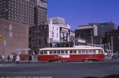 TTC A10 class ex-Cincinnati air-electric PCC #4583 turns from southbound Church onto westbound Wellington while construction on a new TD bank building on the corner takes place. Almost 50 years later, the building is now a Pizzay Pizza, and the corner has been built up significantly. Photo by John F. Bromley.