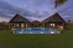 This five-bedroom villa sits on just over half an acre on the western coast of Viti Levu, the largest island in the Fiji archipelago. New Zealand owners Emma and Oliver Rich, who both work in the construction business in Fiji, purchased the land in November 2013 and spent the next year designing and building the 5,000-square-foot home.