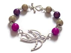 Swooping Swallow Bracelet Miracle Beads by Squintessential on Etsy, £7.00