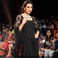 Radiant Karisma Kapur walks the ramp to showcase a design by jewellery brand Kays Jewels during the India International Jewellery Week (IIJW), held at Grand Hyatt, Mumbai, on August 07, 2013.