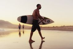 A Man Walking With His Surfboard On Valdevaqueros Beach; Tarifa Cadiz Andalusia Spain Poster Print (19 x 12)