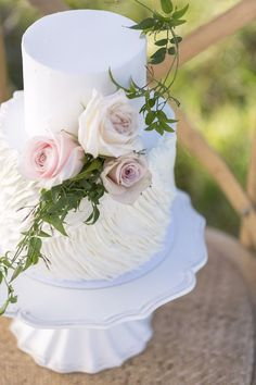 Two tier white cake with flowers   Christina Schmidt Photography