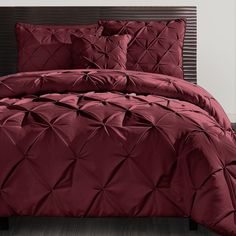 The elegant Carmen three-piece duvet cover set is beautifully crafted with puckered diamonds throughout its woven design. Seen here in burgundy the set comes in several different colors, which allows for coordination with a variety of room furnishings.  #VCNYHome #Duvet