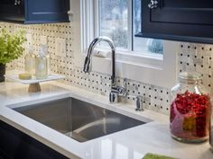 Transitional Kitchen with Complex Marble Tile, Stone Tile, Limestone counters, Undermount Sink, Inset cabinets, One-wall