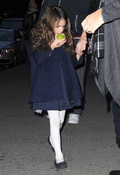 Suri Cruise's Best Fashion Moments, So Far At only 7, this little lady has donned more darling outfits than most of us could count in kindergarten. . . . White Tights - Suri looked like an American Girl Doll (Samantha, to be precise) in this navy topper and white tights.  The perfect winter ensemble, no?