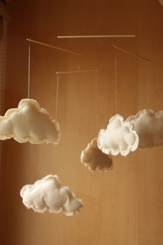 would love to figure out how to make and hang little clouds like this around the kids' room