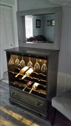 Repurposed Dresser into lighted wine cabinet