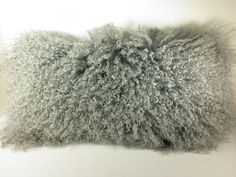 """REAL MONGOLIAN (TIBETAN) LAMB FUR PILLOWONE SIDED GRAY MONGOLIAN FUR PILLOW MEASURING APP. 11""""X22"""" WITH GRAY FAUX SUEDE BACK< MEASUREMENTS ARE TAKEN FROM THE LEATHER SIDE OF THE FUR AND THE FABRIC NOT FROM THE HAIRCUSTOM SIZES AVAILABLE AVAIL"""
