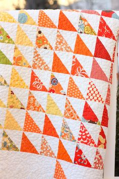 """Amy Smart used a rainbow of colorful fabrics to make this beautiful Spectrum Half Square Triangle Quilt. Here's what Amy had to say about her quilt and working with half square triangles: """"This is …"""