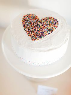 A beautifully decorated cake can make a statement at any shower. Tie in with the theme by easily adding a heart filled with sprinkles to a basic white frosted cake. Place cake on a pretty pedestal for the perfect presentation. Click here to download the heart-shaped templateand then get the instructions.