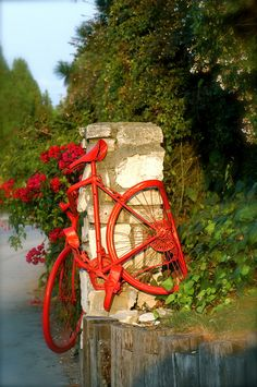 "A Red Bicycle | ""Get a bicycle.  You will not regret it if you live.""  Mark Twain / This red bike art is located at the corner of Hawthorne and Ravenspur in Rolling Hills, CA."