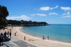 Devonport Beach, Devonport, Auckland, New Zealand.  We like to get fish and chips from the shops and eat them as a picnic on this beach =)