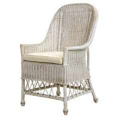Hand-woven+of+natural+rattan+and+featuring+a+white+finish,+this+arm+chair+brings+a+classic+touch+to+your+sunroom+or+den.+++  Product:...