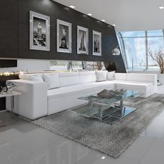 Modern White Leather Sectional With Pale Blue Pillows In