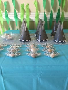 Shark party hats and mermaid crowns for favors. Little mermaid