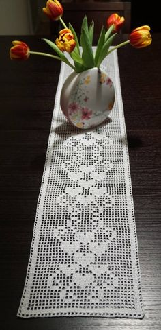 This white long doily with hearts is a perfect addition to your home and looks beautiful on your table. The doily is around 23x126 cm / 9x49,6 inches in size. The material is a 100% cotton thread. The doily is lightly starched using liquid starch. The doily can be washed at 40c,