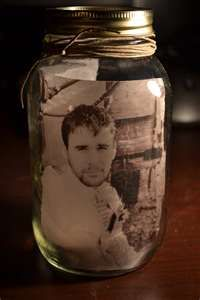 PIcture inside Mason Jars. Cute idea for placing pictures on a kitchen shelf instead of frames.