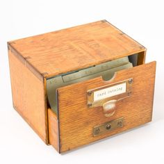 """Replica card catalog box holds 30 unique cards and envelopes, each depicting an image of vintage cards from the Library's collections. 5"""" x 3"""" cards."""