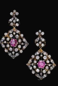 A 19th century pair of ruby and diamond earrings. The pair of earrings set with circular-cut and cushion-shaped rubies, circular-cut and rose diamonds, screw back fittings.