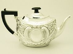 A fine and impressive antique Edwardian English sterling silver teapot; an addition to our silver teaware collection  http://www.acsilver.co.uk/shop/pc/Sterling-Silver-Teapot-Antique-Edwardian-49p4461.htm