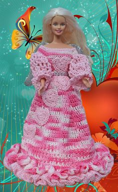 Doll Information:  The Valentine Angel is created from pink and verigated pink cotton crochet thread. The small hearts on her gown are crocheted and hand sewn onto the gown. She is trimmed with silver wings, and silver sash.   This doll includes: • A doll from the Barbie and friends collection,  •Gown  •Wings •Halo •Shoes