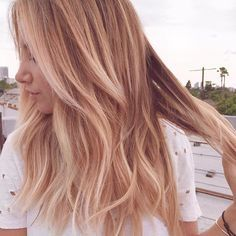 Layered rose gold unicorn hair is a summer style must.