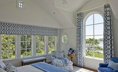 Shingled waterfront home blue and white bedroom with large windows