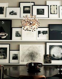 Black & white images in black and white frames on shelves - Bow & Tie
