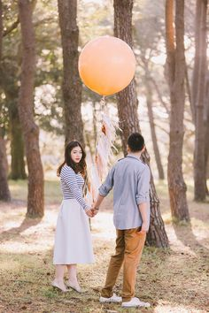 Engagement session in the woods with a giant peach balloon // Jason and Kim's Sun-kissed Engagement Shoot in Sydney