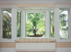 Uniquely-designed bay/now window w/seated nook.