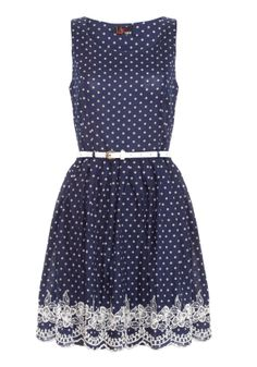 polka dot.  Compare this to the Tory Burch dress, which is much more A-line.