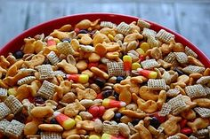 "Halloween Snack Mix ""Candy Corn and Goldfish together at last!""  {Fantastic party snack mix for the kiddo's...Love the dried cranberries in it which my kids already eat all the time!  I used mixed nuts instead of just peanuts}"