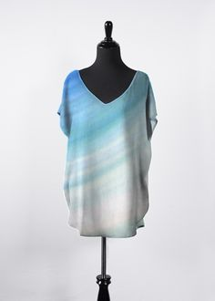 Artist Kelly @ MessiahsDisciple OCEAN & SKY Essential Top This beautiful, flowing top features dolman sleeves, a flattering V-neck and a hi-low silhouette. It will be your new go-to top this season and all year long! Pair it with your favorite tapered pants or skinny jeans for an effortless, day-to-night look.  85.00 USD http://shopvida.com/collections/voices/products/ocean-sky-essential-top