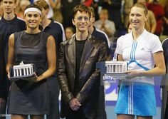Tennis legends Steffi Graf (R) and Gabriela Sabatini (L) and Bee Gees singer Robin Gibb (C) are honoured after an exhibition match by the twon female players at the Max Schmeling Hall, on September 25, 2004 in Berlin, Germany. Graf is in Berlin to also inaugrate a tennis stadium renamed in her name and to host a charity gala.