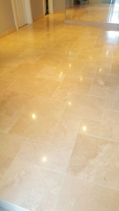 When we arrived at this property in Ayrshire, Edinburgh, it appeared as though the owner's Travertine tiled floor was in relatively decent condition.  On closer inspection, however, we could see that the grout lines were quite dirty and, while there was still a visible shine to the surface, it had become cloudy, likely due to a lack of sufficient maintenance.