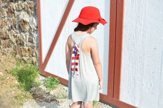 Kids Tank $22|| Kids Floppy Hat $20  Flag Print Dress $34||  Comment below with PayPal to purchase and ship or comment with size for 24 hour hold  #repurposeboutique#hipandtrendy#shoprepurpose#boutiquelove#summer#summerready#4thofjuly#photoshoot