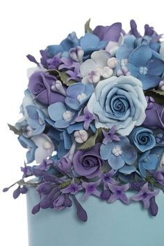 I LOVE this cake. I am a huge fan of purple but this blue is my favorite color and the flowers are perfect! -
