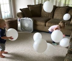 "It was a windy day in our living room today as the littles raced to ""catch the clouds"" with this gross motor balloon activity."