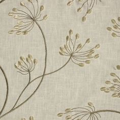 Textured embroidered cream fabric