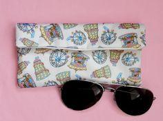 Items similar to Funfair glasses pouch pastel - funfair gift - vintage fairground rides - quirky glasses case - padded sunglasses holder - funfair print on Etsy Sunglasses Case, Pouch, Pastel, Gifts, Etsy, Vintage, Cake, Presents, Sachets
