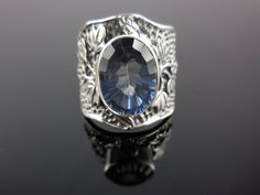 Made with 10x14mm mystic blue quartz gemstone and textured sterling silver metal. Size 8.25