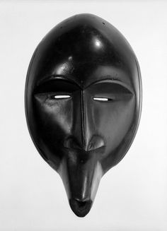 Toura Medium: Wood Dates: late 19th-early 20th century Dimensions: 10 5/8 x 6 1/4 in. (27 x 15.9 cm)   Brooklyn Museum: Arts of Africa: Mask